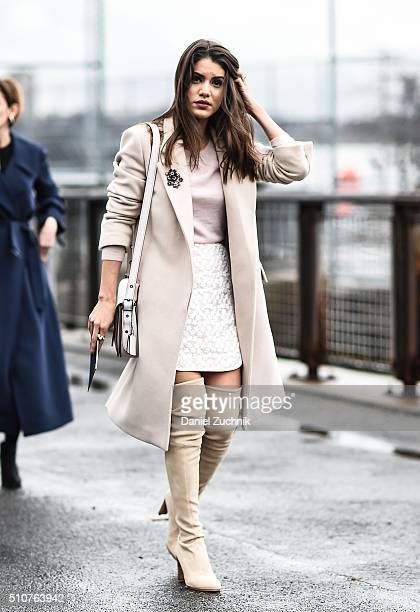 Camila Coelho is seen outside the Coach show wearing a Stella McCartney coat Stuart Weitzman boots and a Coach bag during New York Fashion Week...