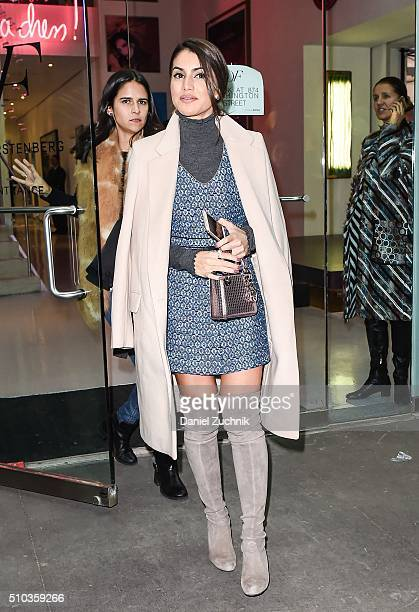 Camila Coelho is seen outside the DVF show wearing a DVF dress during New York Fashion Week: Women's Fall/Winter 2016 on February 14, 2016 in New...