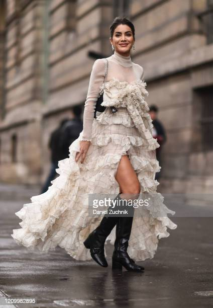 Camila Coelho is seen wearing a Giambattista Valli cream sheer dress outside the Giambattista Valli show during Paris Fashion Week: AW20 on March 02,...