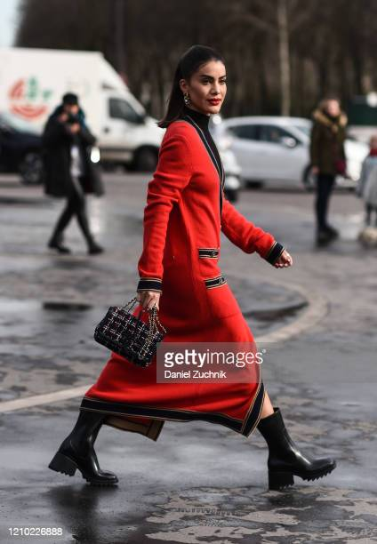 Camila Coelho is seen wearing a red Chanel coat with black bag outside the Chanel show during Paris Fashion Week: AW20 on March 03, 2020 in Paris,...