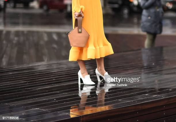 Camila Coelho is seen wearing a Tibi dress and a Danse Lente bag outside the Tibi show during New York Fashion Week Women's A/W 2018 on February 11...