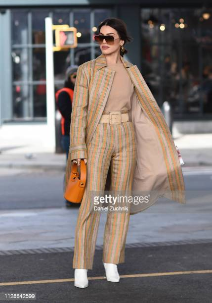 Camila Coelho is seen wearing a Tory Burch outfit outside the Tory Burch show during New York Fashion Week Fall/Winter 2019 on February 10 2019 in...