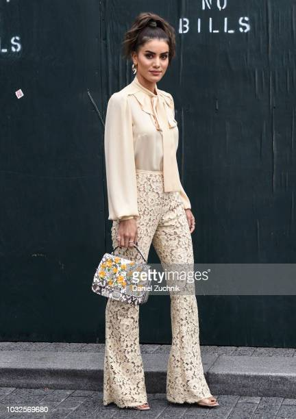 Camila Coelho is seen wearing an offwhite colored top and pants outside the Michael Kors show during New York Fashion Week Women's S/S 2019 on...