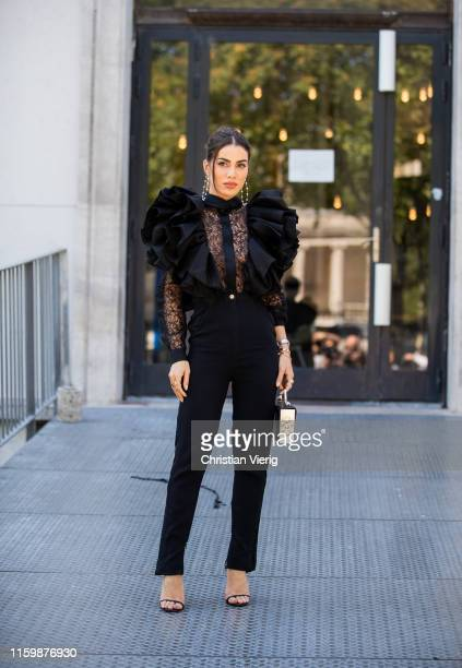 Camila Coelho is seen wearing black laced top, pants outside Elie Saab during Paris Fashion Week - Haute Couture Fall/Winter 2019/2020 on July 03,...