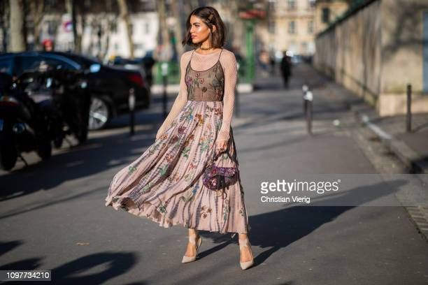 Camila Coelho is seen wearing Dress bag sheer top Dior outside Dior during Paris Fashion Week Haute Couture Spring Summer 2019 on January 21 2019 in...