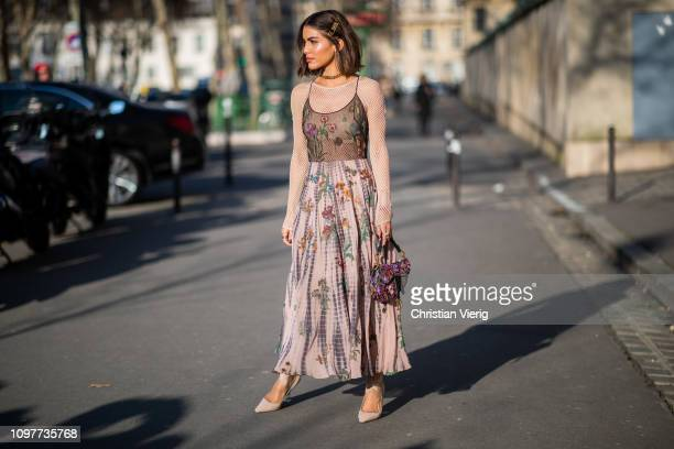 Camila Coelho is seen wearing Dress, bag, sheer top Dior outside Dior during Paris Fashion Week - Haute Couture Spring Summer 2019 on January 21,...