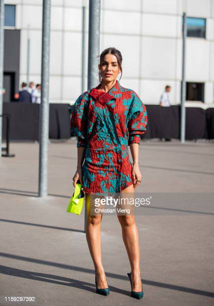 Camila Coelho is seen wearing dress with print neon bag outside Acne during Paris Fashion Week Haute Couture Fall/Winter 2019/2020 on June 30 2019 in...