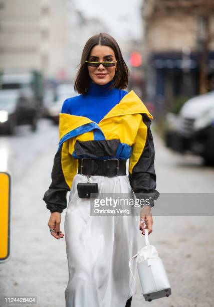 Camila Coelho is seen wearing multri colored jacket, belt with bag, high waist skirt outside Maison Margiela during Paris Fashion Week - Haute...