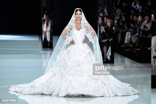 Camila Coelho walks the runway during the Ralph Russo Spring Summer 2018 show as part of Paris Fashion Week on January 22 2018 in Paris France