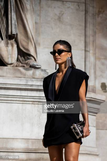 Camila Coelho, wearing a black mini dress and silver bag, is seen outside the Balmain show during Paris Fashion Week - Womenswear Spring Summer 2020...