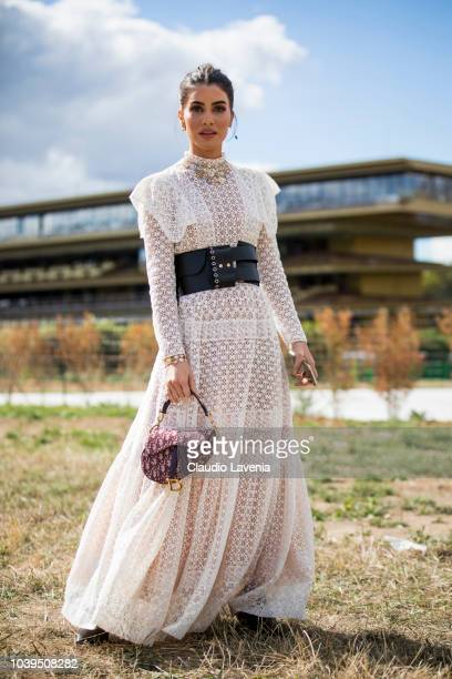Camila Coelho wearing a Dior white dress is seen before the Christian Dior show on September 24 2018 in Paris France
