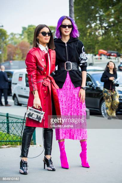 Camila Coelho wearing a red leather trench black leather pants and Louis Vuitton bag and Irene Kim wearing a Chanel Jacket Isabel Marant belt Sies...