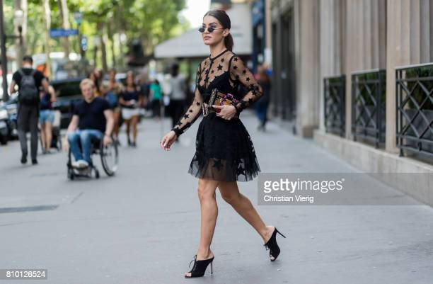 Camila Coelho wearing a sheer black dress outside Elie Saab during Paris Fashion Week Haute Couture Fall/Winter 20172018 Day Four on July 5 2017 in...