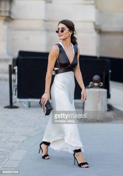 Camila Coelho wearing a white dress black vest outside Ralph Russo during Paris Fashion Week Haute Couture Fall/Winter 20172018 Day Two on July 3...