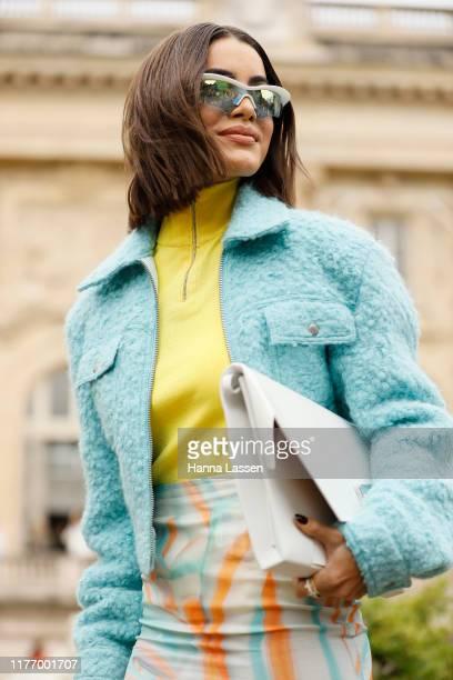 Camila Coelho wearing baby blue cropped jacket yellow turtle neck fringe skirt outside Maison Margiela on September 25 2019 in Paris France