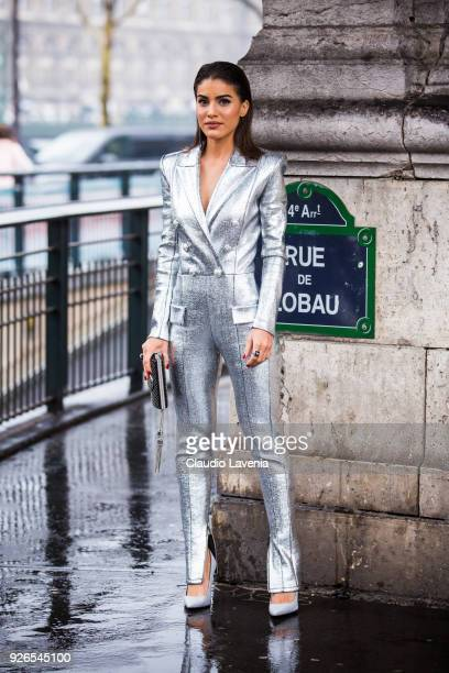 Camila Coelho wearing Balmain silver jump suit and Balmain black clutch is seen in the streets of Paris before the Balmain show during Paris Fashion...