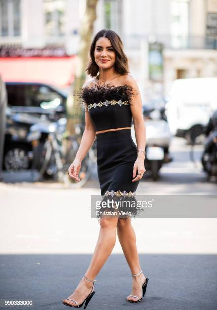 Camila Coelho wearing black cropped off shoulder top skirt is seen outside Ralph Russo on day two during Paris Fashion Week Haute Couture FW18 on...
