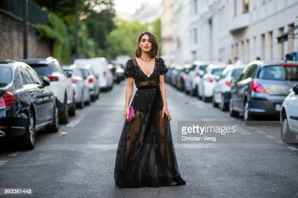 Camila Coelho wearing black sheer dress seen outside Valentino on day four during Paris Fashion Week Haute Couture FW18 on July 4 2018 in Paris France
