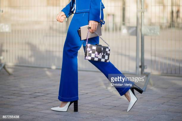 Camila Coelho wearing blue pants cropped top zip jacket seen outside Louis Vuitton during Paris Fashion Week Spring/Summer 2018 on October 3 2017 in...