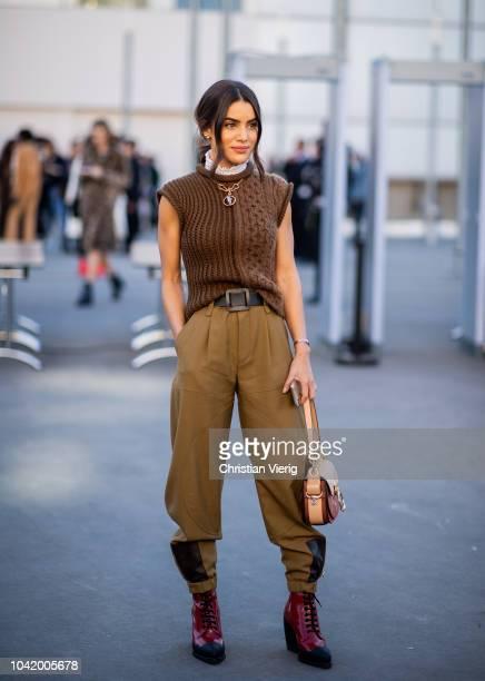 Camila Coelho wearing brown pants sleeveless knit is seen outside Chloe during Paris Fashion Week Womenswear Spring/Summer 2019 on September 27 2018...