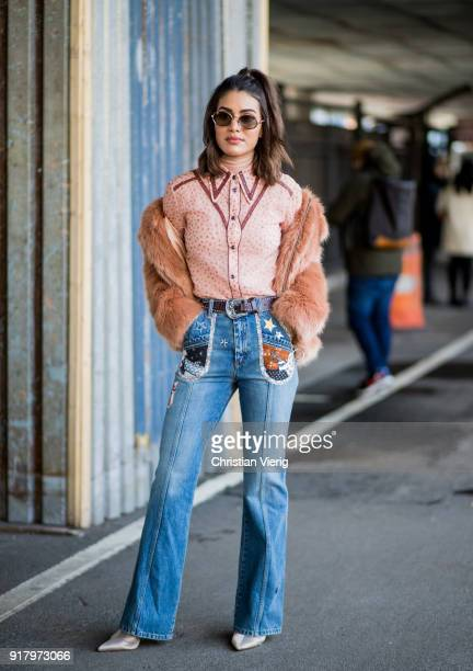 Camila Coelho wearing denim jeans jacket seen outside Coach on February 13 2018 in New York City