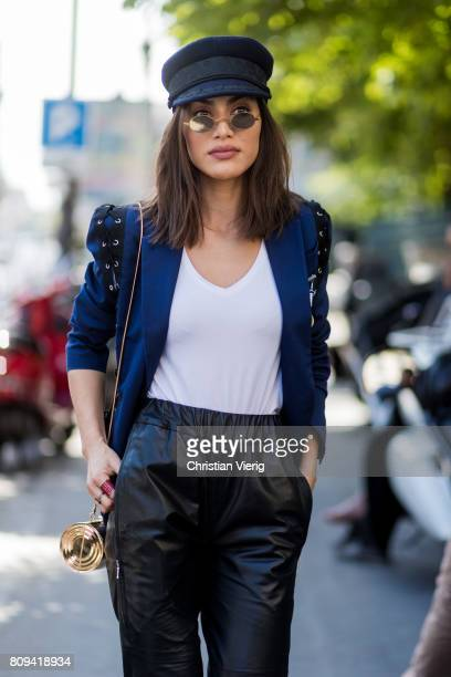 Camila Coelho wearing flat cap white tshirt navy blazer cropped black leather pants heels sunglasses outside Jean Paul Gaultier during Paris Fashion...