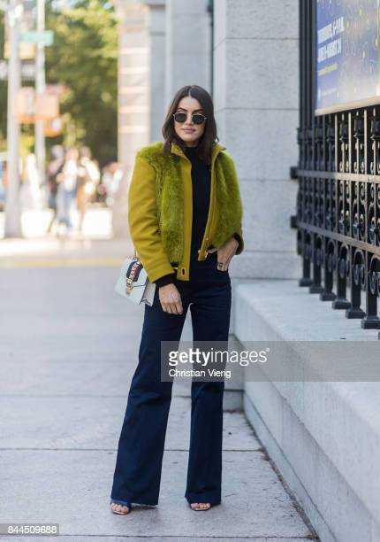 Camila Coelho wearing green jacket navy pants seen in the streets of Manhattan outside Tory Burch during New York Fashion Week on September 8 2017 in...