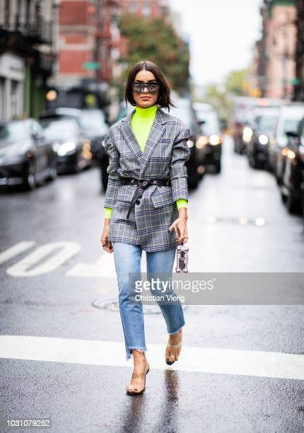 Camila Coelho wearing neon turtleneck grey checked blazer cropped denim jeans is seen outside 31 Phillip Lim during New York Fashion Week...