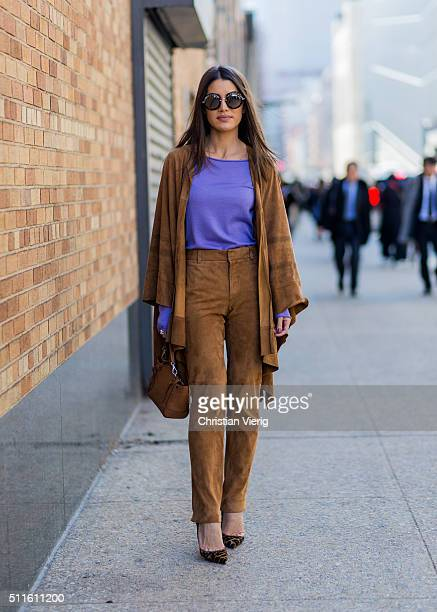 Camila Coelho wearing Ralph Lauren pants jacket and bag seen outside Ralph Lauren during New York Fashion Week Women's Fall/Winter 2016 on February...