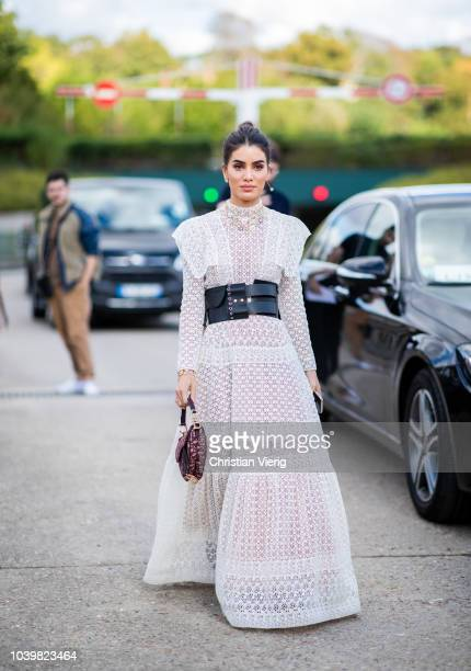 Camila Coelho wearing white sheer dress is seen outside Dior during Paris Fashion Week Womenswear Spring/Summer 2019 on September 24 2018 in Paris...