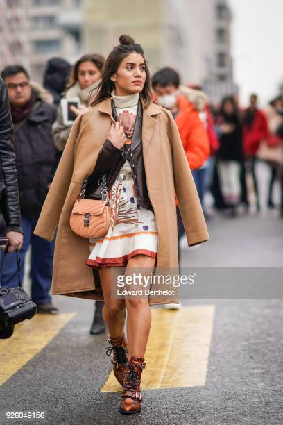 Camila Coelho wears a brown coat a Chloe bag a print dress during Paris Fashion Week Womenswear Fall/Winter 2018/2019 on March 1 2018 in Paris France
