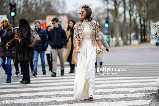 Camila Coelho wears a Chanel jacket a white dress a Chanel bag outside Chanel during Paris Fashion Week Haute Couture Spring/Summer 2018 on January...