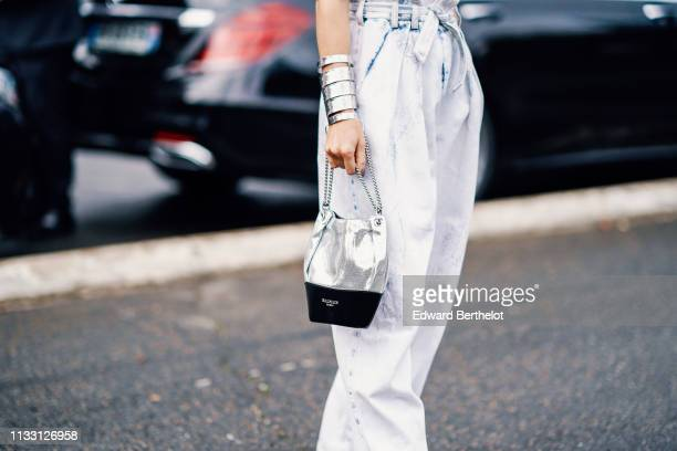 Camila Coelho wears a silver bracelet a silver Balmain bag outside Balmain during Paris Fashion Week Womenswear Fall/Winter 2019/2020 on March 01...