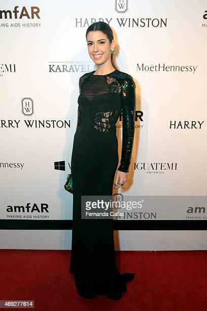 Camila Coutinho attends the 5th Annual amfAR Inspiration Gala at the home of Dinho Diniz on April 10 2015 in Sao Paulo Brazil