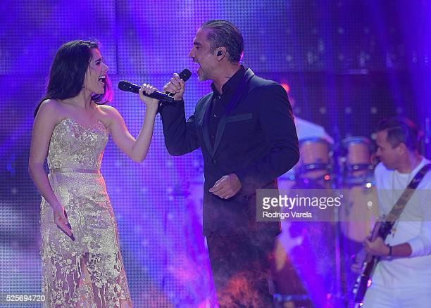 Camila Fernandez and Alejandro Fernandez perform onstage at the Billboard Latin Music Awards at Bank United Center on April 28 2016 in Miami Florida
