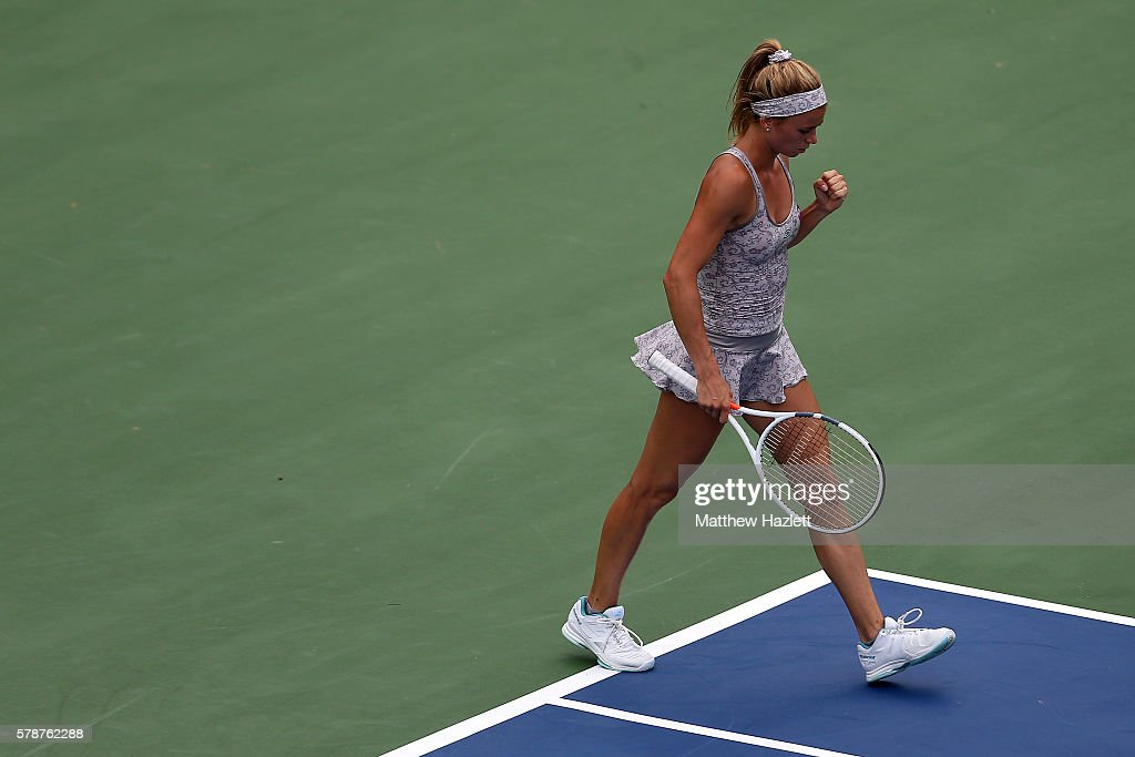 Camila Giorgi of Italy celebrates after defeating Eugenie Bouchard of Canada 7-5, 6-4 during day 2 of the Citi Open at Rock Creek Tennis Center on July 19, 2016 in Washington, DC.