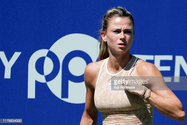 Camila Giorgi of Italy celebrates after Sloane Stephens of the United States during day four of the Toray Pan Pacific Open at Utsubo Tennis Cent on...
