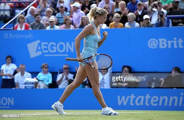 Camila Giorgi of Italy celebrates at match point against Victoria Azarenka of Bulgaria during their Womens Singles match on day four of the Aegon...