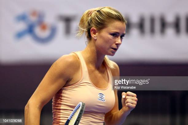 Camila Giorgi of Italy celebrates her victory over Caroline Wozniacki of Denmark in her Singles Round of 16 match on day four of the Toray Pan...