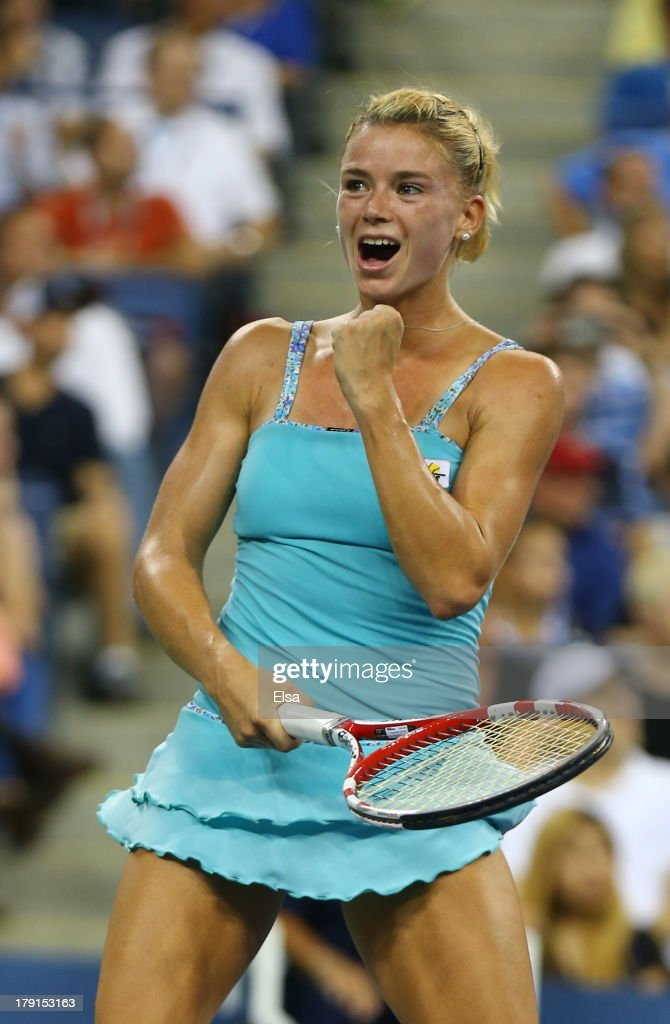 Camila Giorgi of Italy celebrates match point during her wwomen's singles third round mac against Caroline Wozniacki of Denmark on Day Six of the 2013 US Open at USTA Billie Jean King National Tennis Center on August 31, 2013 in the Flushing neighborhood of the Queens borough of New York City.