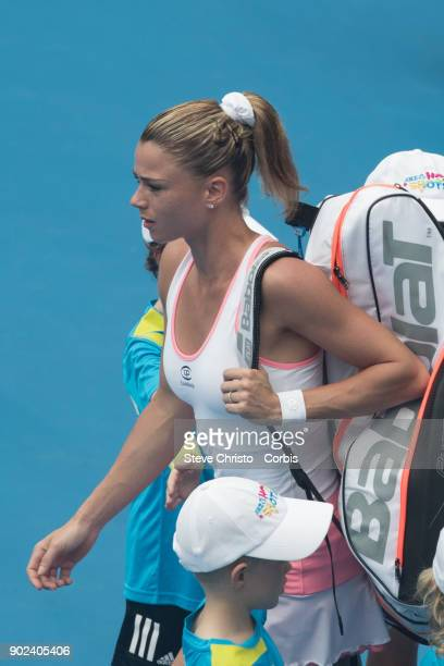 Camila Giorgi of Italy enters the playing arena in her first round match against Sloane Stephens of United States during day one of the 2018 Sydney...