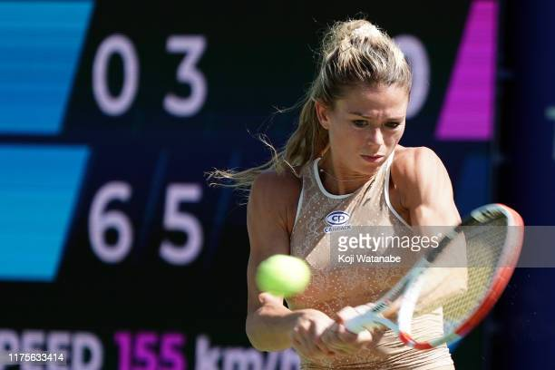 Camila Giorgi of Italy hits a return shot against Sloane Stephens of the United States during day four of the Toray Pan Pacific Open at Utsubo Tennis...