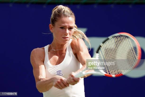 Camila Giorgi of Italy hits a return shot against Xinyun Han of China during day one of the Toray Pan Pacific Open at Utsubo Tennis Cent on September...