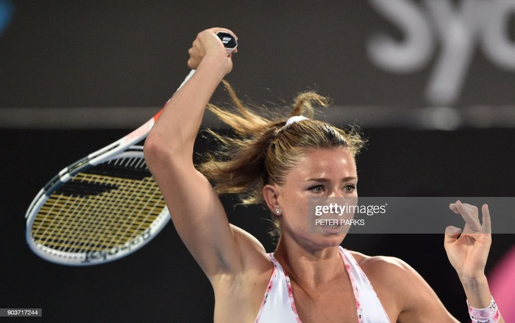 Camila Giorgi of Italy hits a return to Agnieszka Radwanska from Poland in their women's singles quarter-final match at the Sydney International tennis tournament in Sydney on January 11, 2018. /