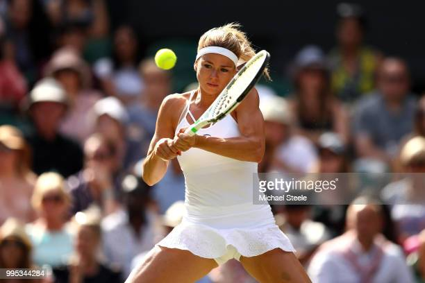 Camila Giorgi of Italy plays a backhand against Serena Williams of the United States during their Ladies' Singles QuarterFinals match on day eight of...