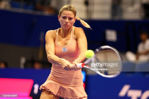Camila Giorgi of Italy plays a backhand during her singles first round match against Misaki Doi of Japan on day one of the Toray Pan Pacific Open at...