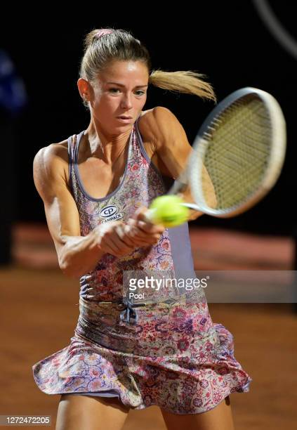 Camila Giorgi of Italy plays a backhand in her round one match against Dayana Yastremska of Ukraine during day one of the Internazionali BNL D'Italia...