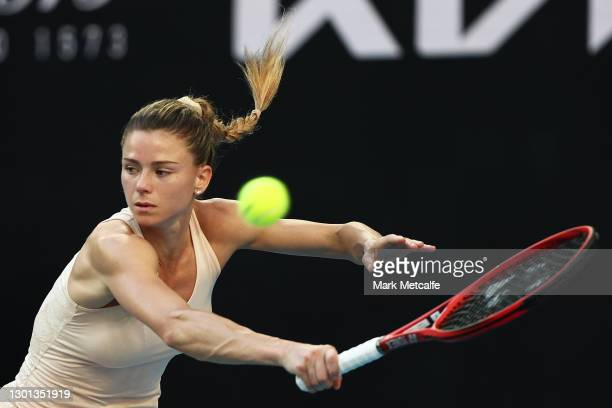 Camila Giorgi of Italy plays a backhand in her Women's Singles second round match against Iga Swiatek of Poland during day three of the 2021...