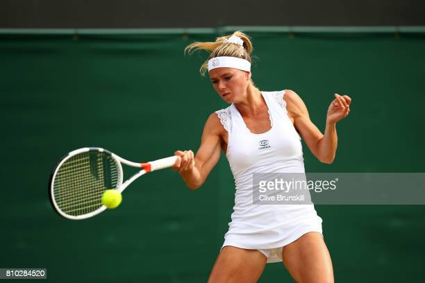 Camila Giorgi of Italy plays a forehand during the Ladies Singles third round match against Jelena Ostapenko of Latvia on day five of the Wimbledon...