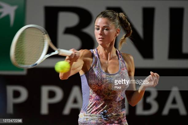 Camila Giorgi of Italy plays a forehand in her round one match against Dayana Yastremska of Ukraine during day one of the Internazionali BNL D'Italia...